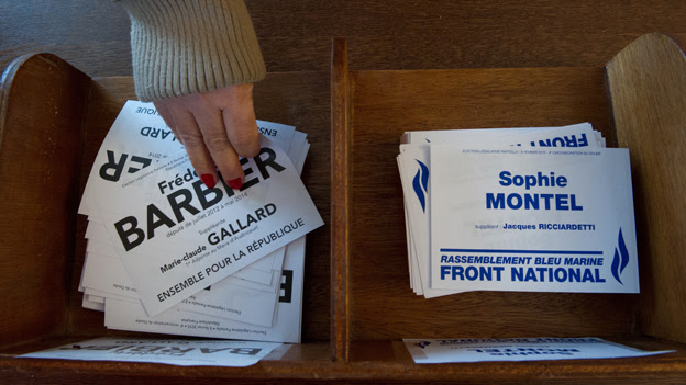 """Hand reaches out for """"Barbier"""" election paper in Doubs by-election in France"""