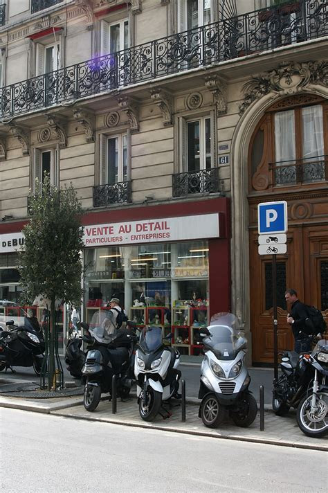 Motorcycles parked on a street in Paris France by Kalin