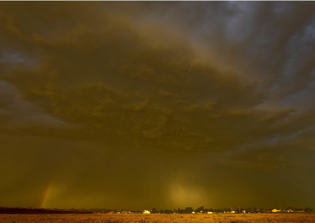 A dust storm hovers over Queen Creek, Ariz. Thursday, Aug. 18, 2011. The dust storm, also known as a haboob in Arabic and around Arizona, swept through Pinal County and headed northeast, reaching Phoe