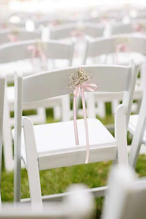 Delicate Baby's Breath ceremony decor tied to white