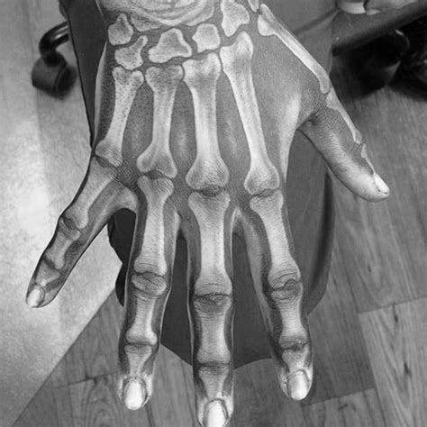 skeleton hand tattoo designs men manly ink ideas