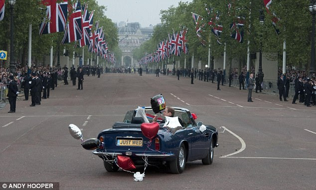 Off to Clarence House: Catherine and William drive off from Buckingham Palace to Clarence House