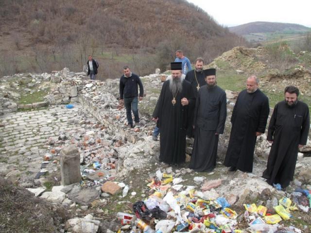 A 2013 file photo showing Bishop Teodosije at Binac, and the garbage dumped at the ruins (eparhija-prizren.com)