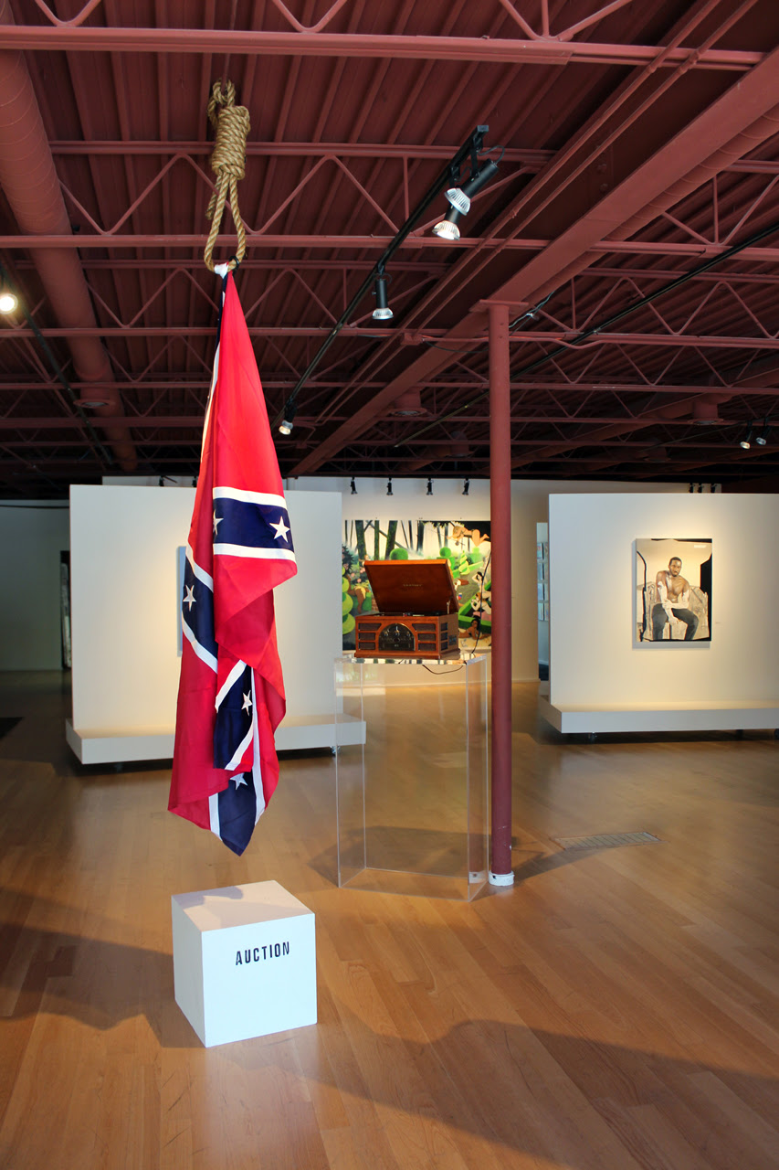 http://hyperallergic.com/wp-content/uploads/2015/08/fig-2-John-Sims-The-Proper-Way-to-Buy-a-Hanging-Confederate-Flag-2015-installation-photograph-courtesy-of-Moberg-Gallery-July-2015.jpg