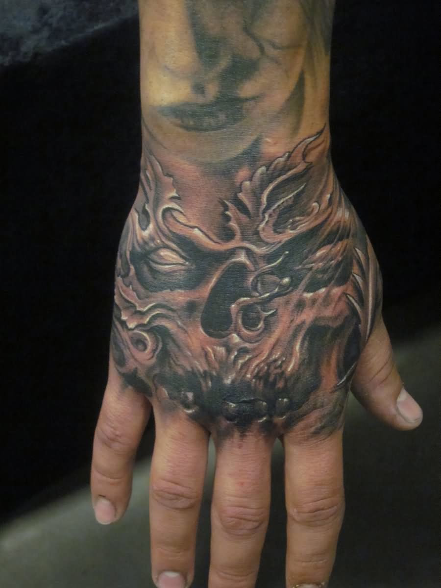 Angel And Demon Skull Tattoo On Hand