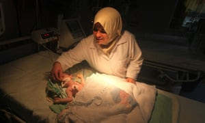 A premature infant receives treatment in a hospital in Gaza. A new UN report says there has been a surge in the rate of infant mortality in Gaza.