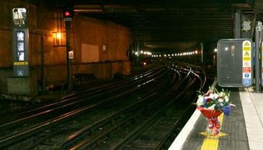 Flowers at Aldgate Station after relatives visited the scene - Picture by Reuters