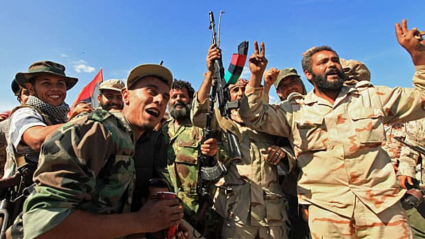 Anti-Gadhafi fighters celebrate the fall of Sirte. Libyan interim government fighters captured Moammar Gadhafi's home town on Thursday, extinguishing the last significant resistance by forces loyal to the deposed leader and ending a two-month siege.