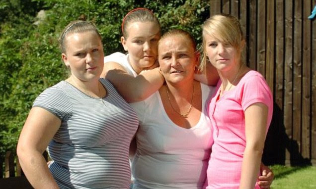Tragic: Mother-of-four Assia Newton (pictured centre, surrounded by her daughters) told 'violent' husband Kelvin she wanted a divorce after falling in love with a waiter named Mohammed while on holiday in Tunisia
