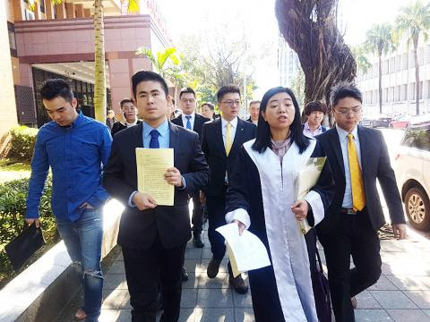 Image result for Lin, New Party spokesman Wang Ping-chung (王炳忠) and fellow party Youth Corps members Hou Han-ying (侯漢廷) and Chen Shu-chun