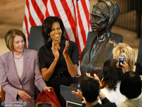 Speaker Nancy Pelosi and first lady Michelle Obama applaud the unveiling of the Sojourner Truth bust.