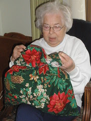 Mom with Gift in Fabric Bag