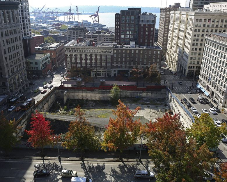 The site of the stalled Triad Capital Partners project can be seen from the public terrace off the  seventh floor of City Hall office. (Ken Lambert / The Seattle Times)