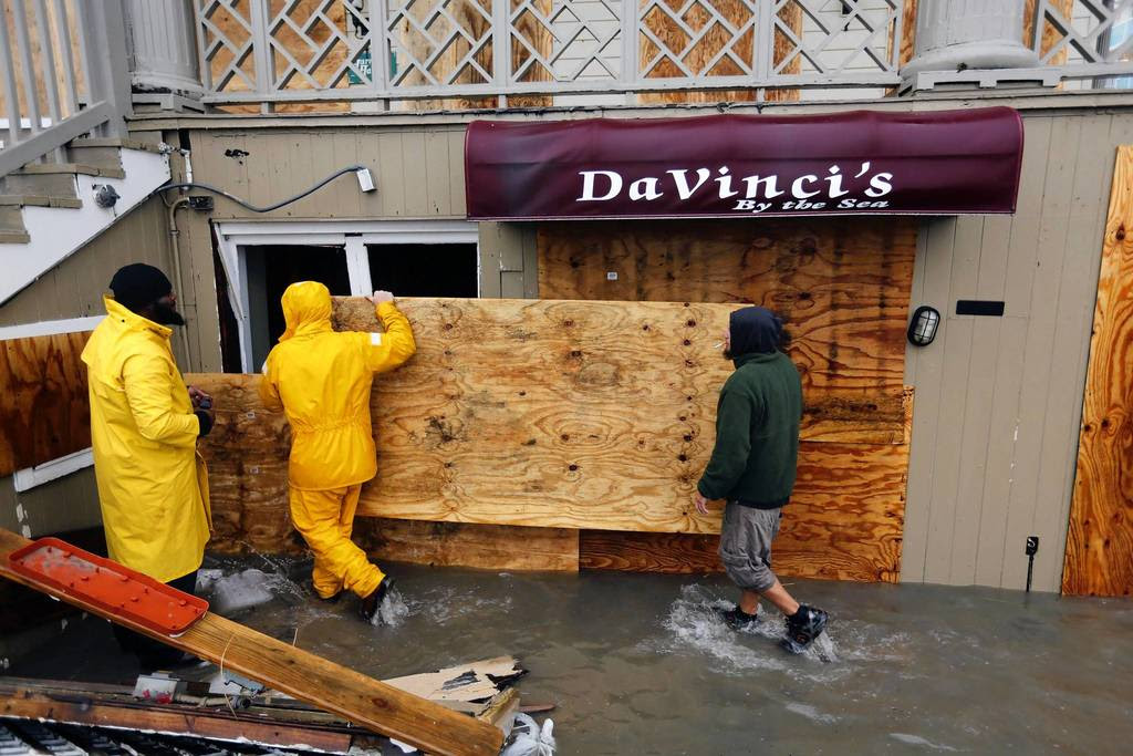 An oceanfront restaurant is boarded up after waves crashed over the boardwalk in Ocean City, Maryland, while Hurricane Sandy intensifies. About 50 million people from the Mid-Atlantic to Canada were in the path of the nearly 1,000-mile-wide (1,600-km-wide) storm, which forecasters said could be the largest to hit the mainland in U.S. history.