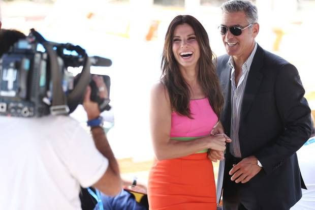 Bright sparks: Sandra Bullock, in a colour block dress, and George Clooney have a ball at the Gravity photocall