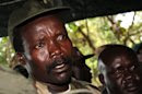 FILE - In this Nov. 12, 2006, file photo, the leader of the Lord's Resistance Army Joseph Kony answers journalists' questions following a meeting with UN humanitarian chief Jan Egeland at Ri-Kwangba in southern Sudan. A report by the watchdog group Resolve on Friday, April 26, 2013, says the fugitive African warlord Joseph Kony recently found safe haven in territory along the Sudan-South Sudan border, controlled by Sudan and that Kony benefits from Sudanese military support. (AP Photo/Stuart Price, File, Pool)