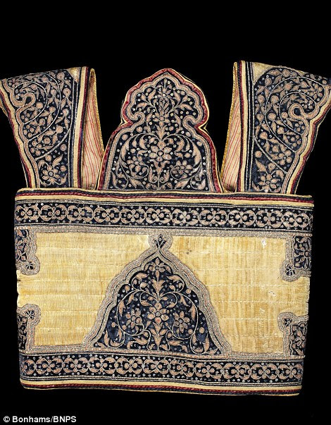 A metal-thread embroidered quilted velvet quirass, expected to sell for £20,000
