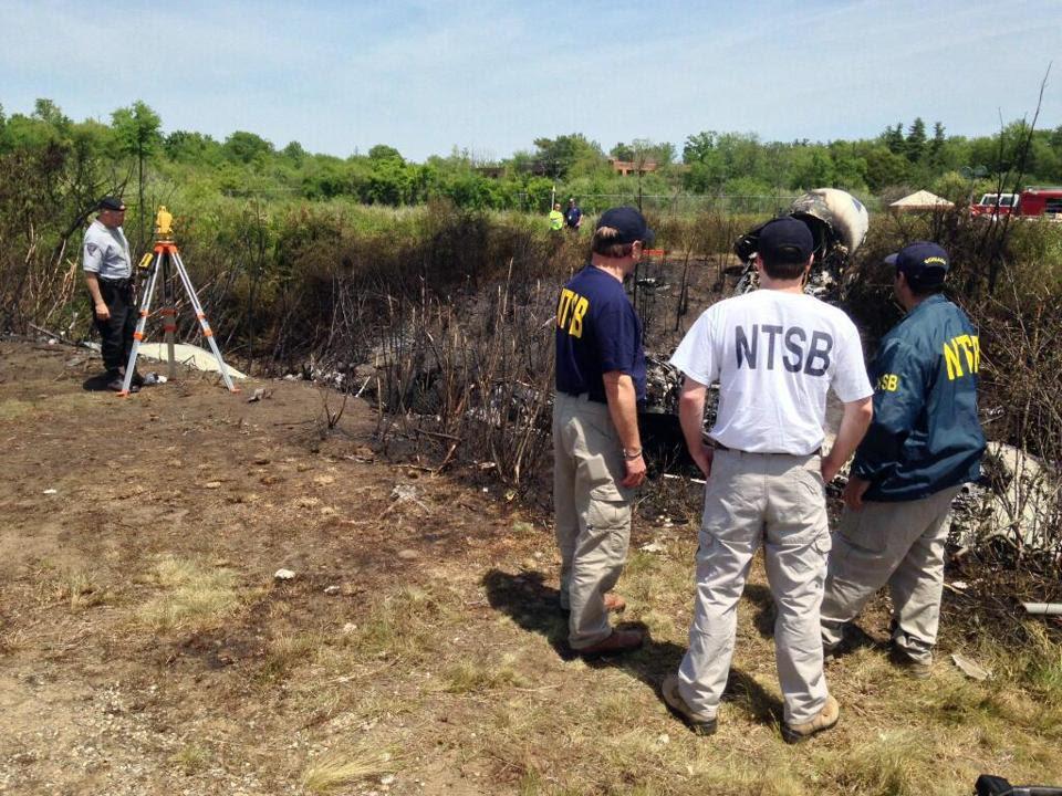National Transportation Safety Board investigators were at the scene of the crash Sunday.