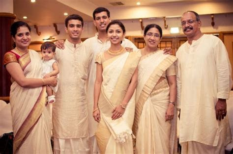 Family and friends in elegant cream and gold at a #kerala