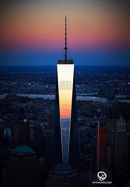 The Sun reflects off of the 1 World Trade Center's (1 WTC) shiny facade, on October 13, 2014.