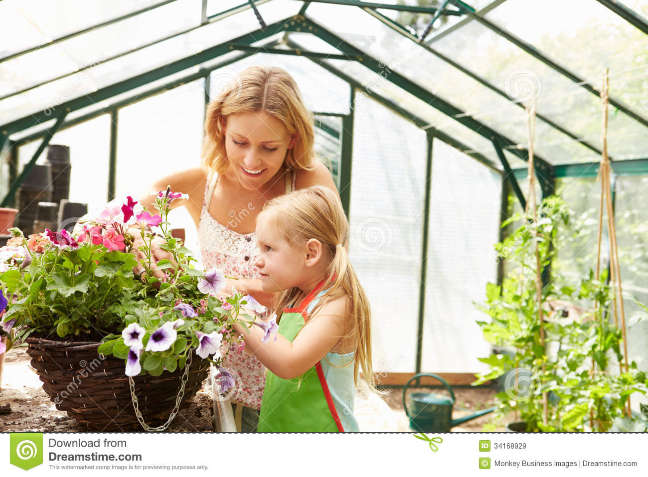Download Mother And Daughter Growing Plants In Greenhouse Royalty ...