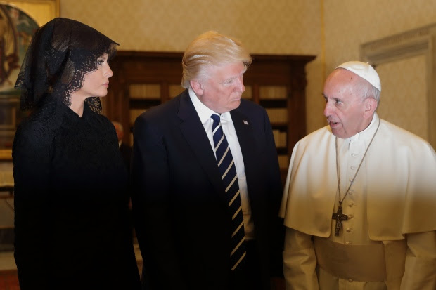 Pope Francis (R) speaks with US President Donald Trump (C) and US First Lady Melania Trump during a private audience at the Vatican on May 24, 2017. US President Donald Trump met Pope Francis at the Vatican today in a keenly-anticipated first face-to-face encounter between two world leaders who have clashed repeatedly on several issues. / AFP PHOTO / POOL / Alessandra Tarantino        (Photo credit should read ALESSANDRA TARANTINO/AFP/Getty Images)