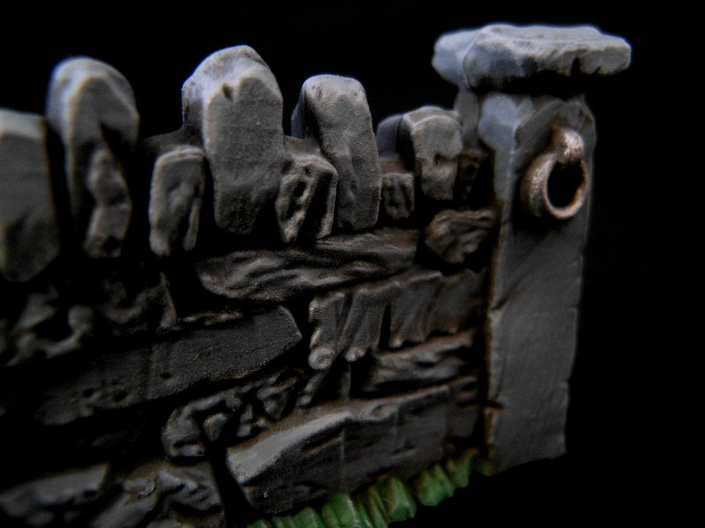 Close up photograph showing the detail on a painted Games Workshop wall.