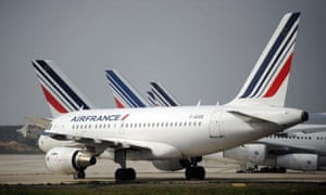Air France planes are parked on the tarmac of Charles de Gaulle airport