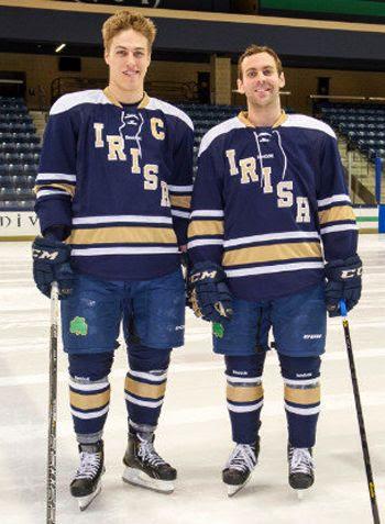 Notre Dame Hockey City Classic jersey photo AndersLeeleftandSamCalabreseleftwearingthethrowbackjerseysthatNotreDamewillwearintheOfficeMaxHockeyCityClassiconFeb17atChicagosSoldierF.jpeg