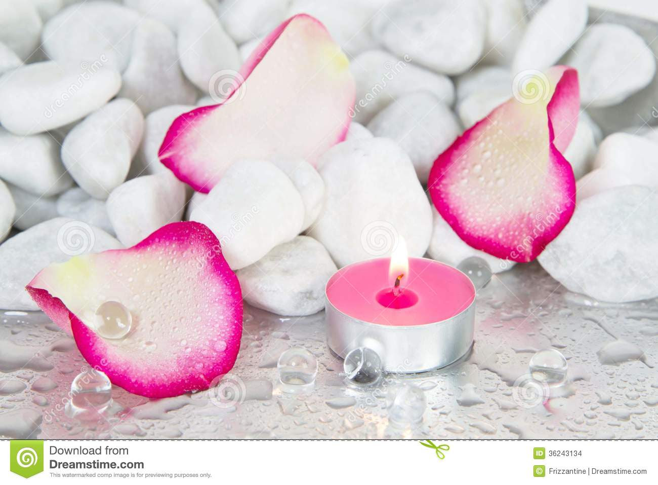 Rose Petals And A Lit Candle For A Spa Decoration Stock Images ...