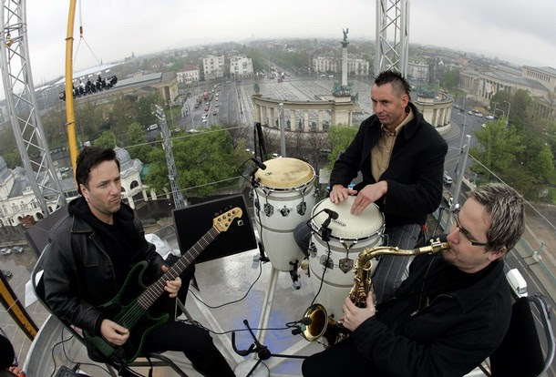 Musicians play while guests have lunch at a new event venue