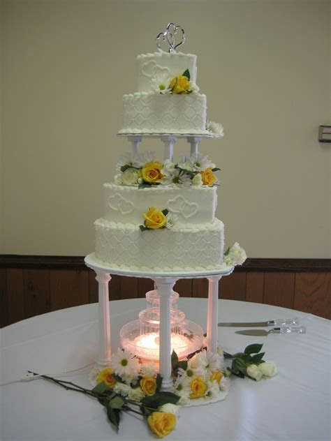 4 tier heart shaped wedding cake with fountain and fresh