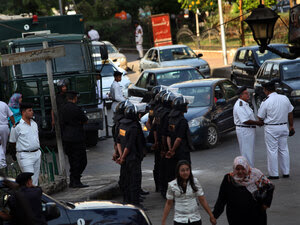 Riot police stand guard in anticipation of a petition drive by Mohamed ElBaradei's political party