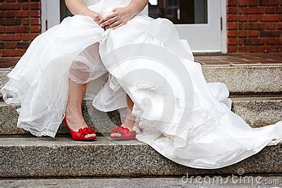 Bride Wearing White Wedding Dress And Red Shoes Stock