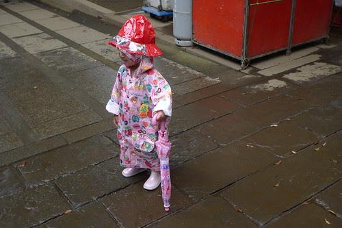 Little girl in a cute raincoat