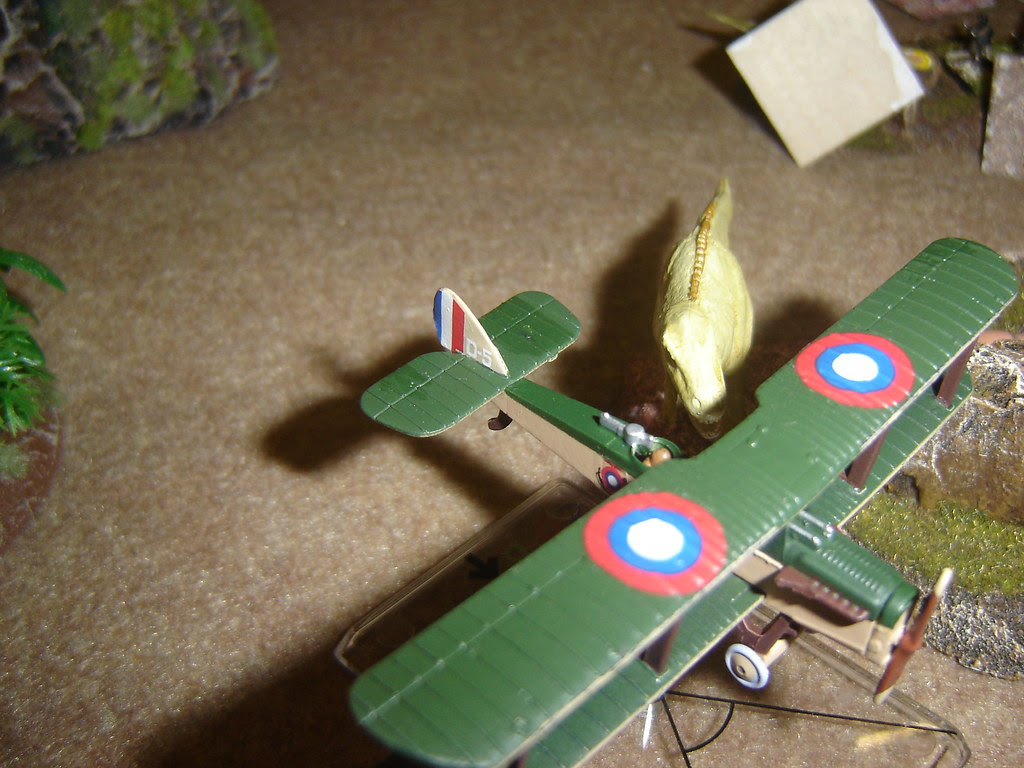 Low-flying Biplane attacked by Tyrannosaur