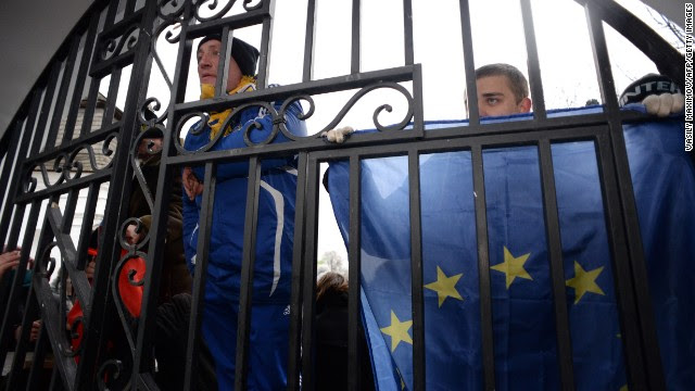 Opposition supporters hold flags of the European Union on November 30 as they guard the gates of the Mikhailovsky monastery.