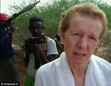 Rachel Chandler and her Somali captors. The British couple has made a direct plea on video warning UK authorities they fear the 'kidnappers are losing patience' and may kill them