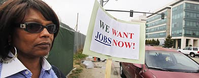 Unemployed Diana Jackson holds up sign looking for work in construction during a workers rally outside of a construction zone in San Francisco, Thursday, Sept. 16, 2010. (AP Photo/Paul Sakuma)