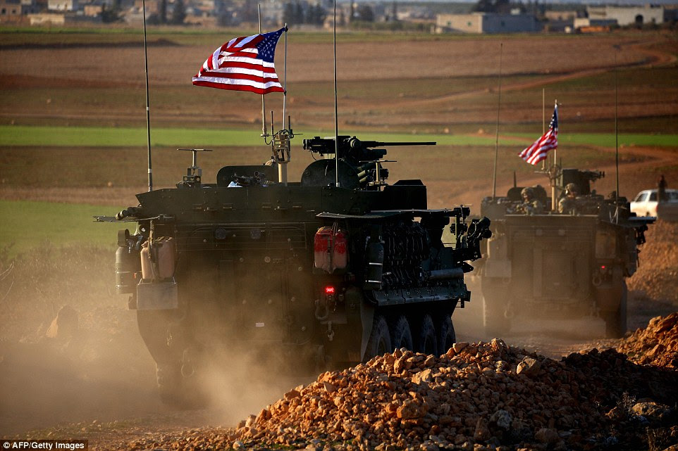 The United States has deployed armored personnel carriers to the outskirts of the northern Syrian city of Manbij