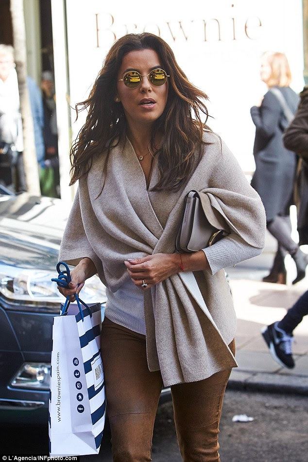 It's a wrap-up: The Desperate Housewives star kept herself cosy in a wrap-around cardigan
