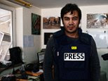 Agence France-Press (AFP) reporter Sardar Ahmad was killed in the attack on Kabul's Serena hotel. This picture was taken just hours before Mr Ahmad, his wife and two of his three children were gunned down