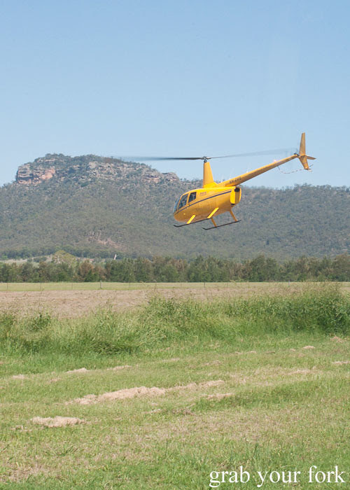 helicopter taking off back to Sydney at Margan Wines in Broke, Hunter Valley