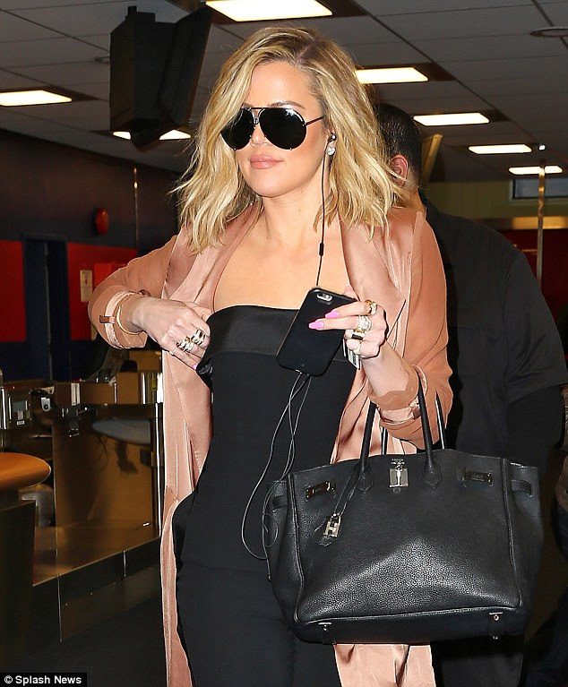 Wheels up: The Kardashian Kollection designer at JFK airport after her brief trip to Manhattan