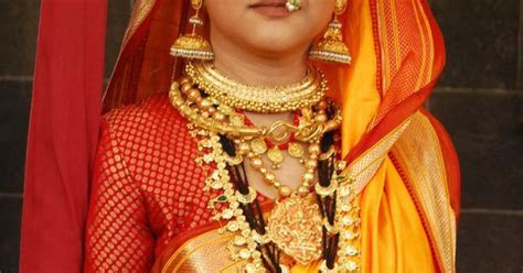 Marathi Style in a Bright Yellow Saree with a Red and Gold