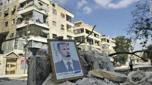 A portrait of al-Assad sits on rubble along a street in the Saif al-Dawla district of the northern city of Aleppo on Tuesday