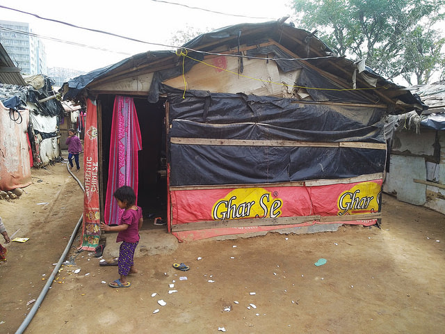A child plays outside a makeshift home in a Rohingya camp, Jammu, India. Credit: Stella Paul/IPS