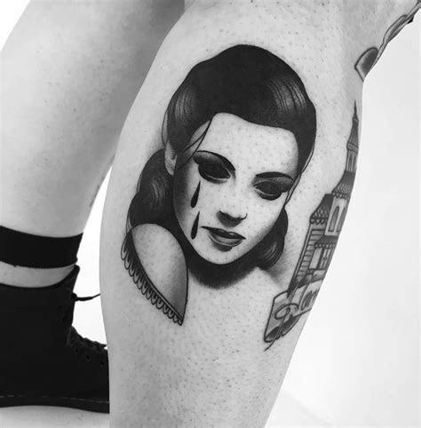 eerie tattoos women soulless eyes slumdog