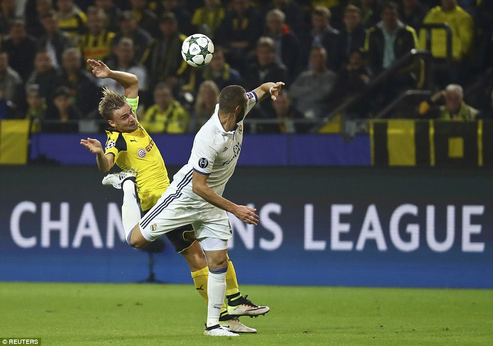 Schmelzer is in the thick of the action once more as the German left back battles for possession with Karim Benzema
