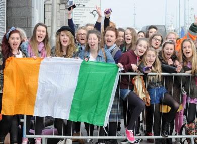 One Direction fans wait outside the O2 in Dublin.